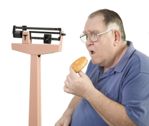 bigstockphoto_Big_Guyand_Donut_Looking_At_Sc_3131832